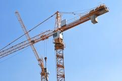 Tall yellow tower crane Stock Image