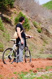 tall  young man biking in the mountain Stock Images