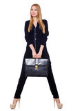 Tall young woman in black clothing with handbag. The tall young woman in black clothing with handbag isolated on white Stock Photography