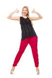 The tall young woman in red pants isolated on white Stock Image