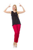 The tall young woman in red pants isolated on white Royalty Free Stock Photography