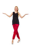 The tall young woman in red pants isolated on white Royalty Free Stock Photo