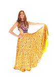 Tall young woman in yellow skirt. Royalty Free Stock Image