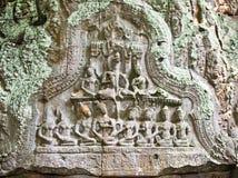 Talla antigua en la pared de Prasat TA Prum Temple, Camboya Fotos de archivo libres de regalías
