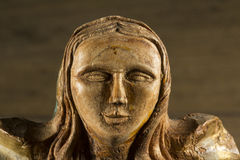Talla de madera religiosa. The face of a wood carving of Christian religion royalty free stock photography