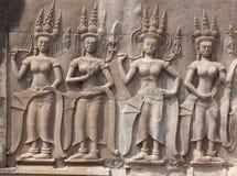 Talla de piedra de los bailarines de Apsara Fotos de archivo libres de regalías