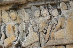 Talla del alivio de Bas de músicos en Borobudur Imagen de archivo libre de regalías