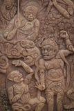 Talla tailandesa en la pared de piedra Fotos de archivo libres de regalías
