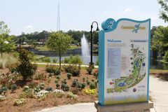 Cascades Park Entrance Sign and Landscape. Tallahassee, FL, USA - May 13, 2018: Cascades Park entrance sign and landscape.View of Cascades Park beautiful stock images