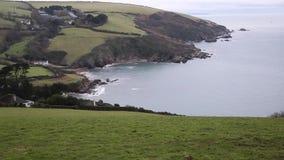 Talland Bay coast Cornwall near Looe England UK pan of coastline stock video footage