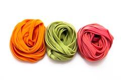 Tallarines coloridos Fotografía de archivo