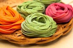 Tallarines coloridos Foto de archivo libre de regalías