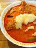 Tallarines del curry con queso Foto de archivo