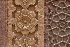 Tallas de piedra en la pared de un templo en la India Imágenes de archivo libres de regalías