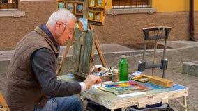 Taller de la pintura de la calle en Malcesine imágenes de archivo libres de regalías