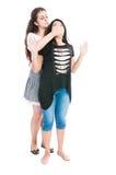 Taller girl bullying her friend Royalty Free Stock Image