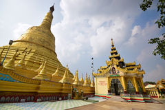 Tallest large stupa on left & House of Worship on right in Shwemawdaw Pagoda at Bago, Myanmar Royalty Free Stock Images