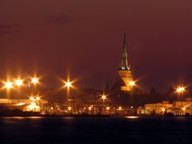 Tallin at night. View of Tallin Old Town over the sea Stock Images