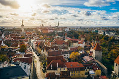 Tallinn city from above view against sun and cloudscape, Estonia Stock Images