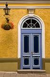 Tallinn color front door. Color front door with lamp and flowerpot royalty free stock photo