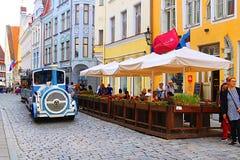 Blue City Train, tourist sightseeing vehicle, is driven through Pikk Steet in the Old Town of Tallinn, UNESCO World Heritage site. Estonia royalty free stock photos