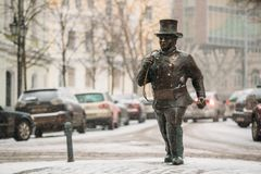 Tallinn, Estonia. Bronze Statue Of A Lucky Happy Chimney Sweep With Some Bronze Footsteps Royalty Free Stock Photo