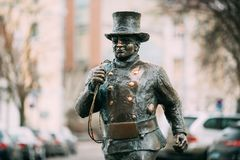 Tallinn, Estonia. Bronze Statue Of A Lucky Happy Chimney Sweep With Some Bronze Footsteps. Tallinn, Estonia - December 2, 2016: Bronze Statue Of A Lucky Happy Stock Photos