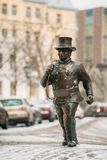Tallinn, Estonia. Bronze Statue Of A Lucky Happy Chimney Sweep With Some Bronze Footsteps Stock Photo