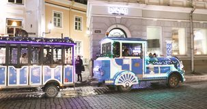 Tallinn, Estonia - December 21, 2017: People Having Travel By Holiday Decorative Train For Sightseeing On Town Hall. Square stock video