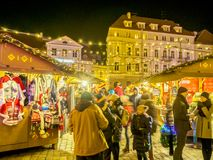 Christmas Fair at Town Hall Square in Tallinn. TALLINN, ESTONIA - DETSEMBER 01, 2018: Many Tourists and Christmas Fair at Town Hall Square. Holiday garlands stock photos