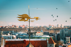 Tallinn, Estonia, Europe. Close Up Of Cock-rope Weather Vane On Roof Of Old Medieval House Stock Image