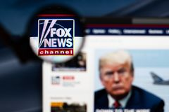 Fox News Channel logo visible through a magnifying glass. stock image