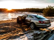 Metallic Volkswagen Passat cc at the Manniku Lake stock photos