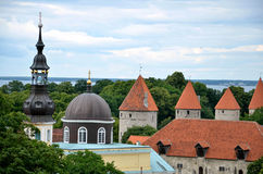 TALLINN / ESTONIA - July 27, 2013: Church of the Transfiguration of Our Lord in Tallinn next to medieval town wall. Baltic sea in background Royalty Free Stock Image