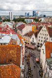 Tallinn, Estonia - 7 July 2015. Red tiled roofs, streets and business buildings of old town Royalty Free Stock Images