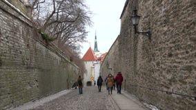 Tourists walk through the street Pikk jalg Long leg. Toompea, Estonia stock footage