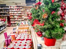 Christmas ornaments shop and visitors stock photos