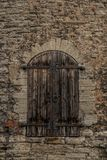 Tallinn, Estonia: Old wooden door in the Fortress wall and towers. UNESCO world heritage site. Popular tourist destination in Estonia`s capital stock images