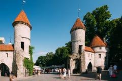 Tallinn, Estonia. People Walking Near Famous Landmark Viru Gate Stock Image