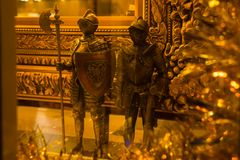 Tallinn, Estonia: Statues of gold medieval knights in the souvenir shop. Tallinn, Estonia: Beautiful dStatues of gold medieval knights in the souvenir shop royalty free stock images