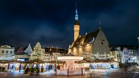 Tallinn, Estonia. Time-lapse Of Traditional Christmas Market And Carousel In Town Hall Square. Christmas Tree And stock video footage