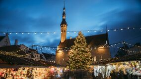 Tallinn, Estonia. Timelapse Time-lapse Of Traditional Christmas Market In Town Hall Square. Christmas Tree And Trading stock video