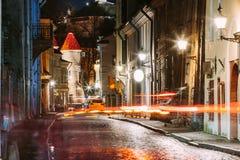 Tallinn, Estonia. Traffic Lights Trails In Night Street Near Famous Landmark Viru Gate In Street Lighting At Evening Royalty Free Stock Image