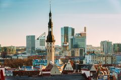 Tallinn, Estonia. View Of Tower Of Tallinn Town Hall On Background. Tallinn, Estonia. Tower Of Tallinn Town Hall On Background Of Modern Architecture. Oldest royalty free stock photo