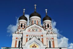 Tallinn Nevsky Cathedral. Domes with a blue sky on the background Royalty Free Stock Photos