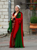 TALLINN November 2. Girl in medieval dress in Town Hall Square i Royalty Free Stock Images