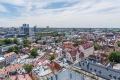 Tallinn old town and financial center. The financial center and the old town of Tallinn on a summer day as seen from the Oleviste church tower Stock Photos