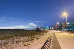 Tallinn, Rock-al-Mare promenade at night. Estonia, Tallinn, promenade in Rock-al-Mare at night. Pedestrians path in perspective, street lights stock image