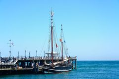Tallship along pier, Swanage. Stock Photos