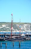 Tallship along pier, Swanage. Royalty Free Stock Photography
